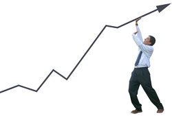 business man holding up a black arrowing going up