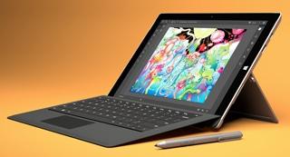 Blog image black microsoft surface pro 4 on a orange background