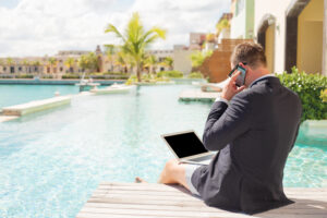 Blog image workaholic working by the pool during his vacation