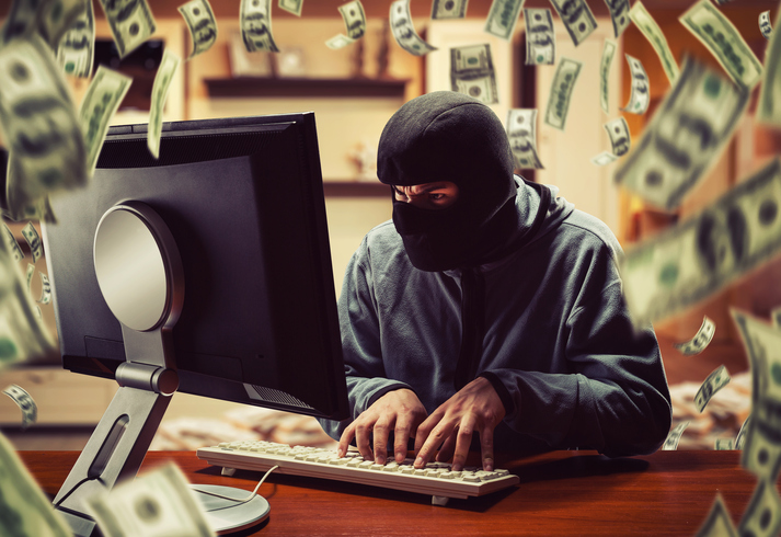 Blog image Hacker in mask stealing information and money at home