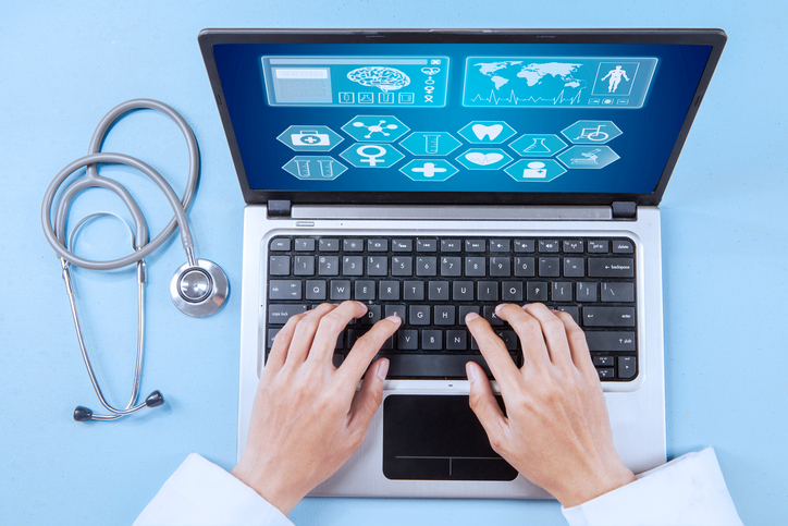 Blog image Close up of male doctor working on a laptop for analyzing human illness