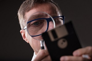 Blog image man checking data with a magnifier