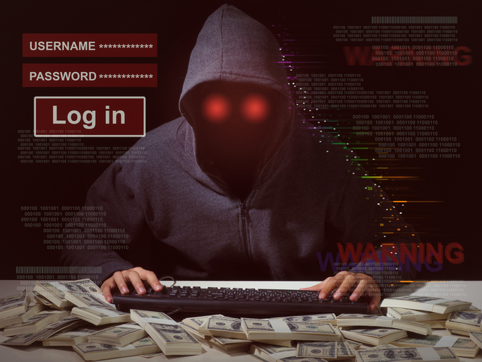Blog image Cyber attack with unrecognizable hooded hacker.Man in hoodie is hacker