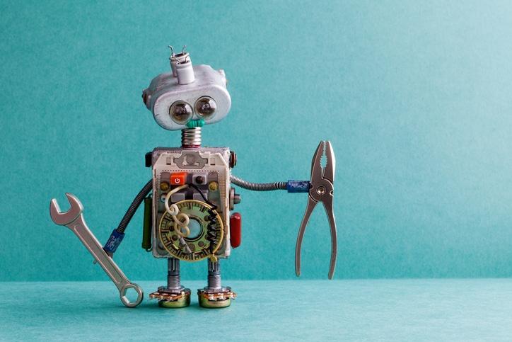 Blog image robot holding tools on a light blue background