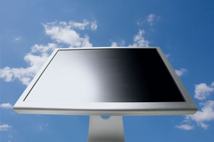 Computer monitor with background of blue sky and clouds