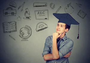 blog image man with gradation cap looking off into the distance with background of hand draw symbols of school subjects