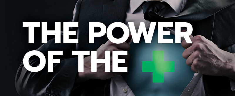 Business man opening shirt with green cross of chest with white text of the power of the +